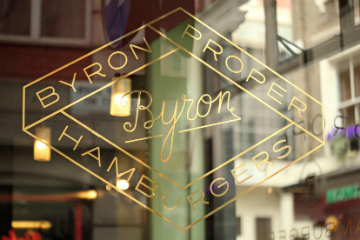 Byron burger logo in gold on a window